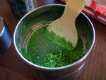 Green tea powder being sieved - from frangipani