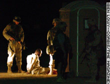 The suspected US soldier is detained under armed guard